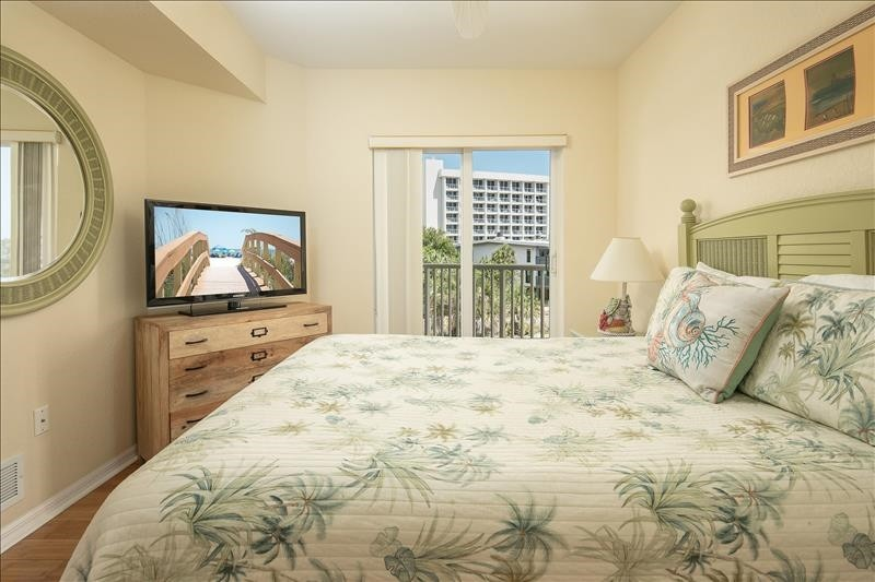 master bedroom with balcony access and gulf views