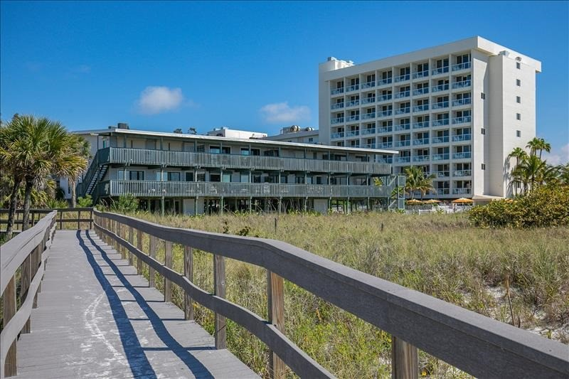 Boardwalk to Beach from behind building