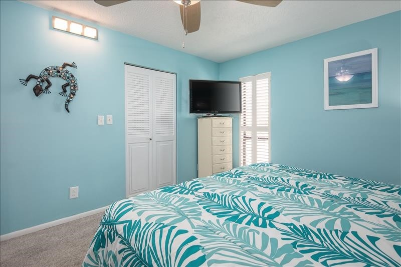 Roomy master bedroom with comfortable furnishings!