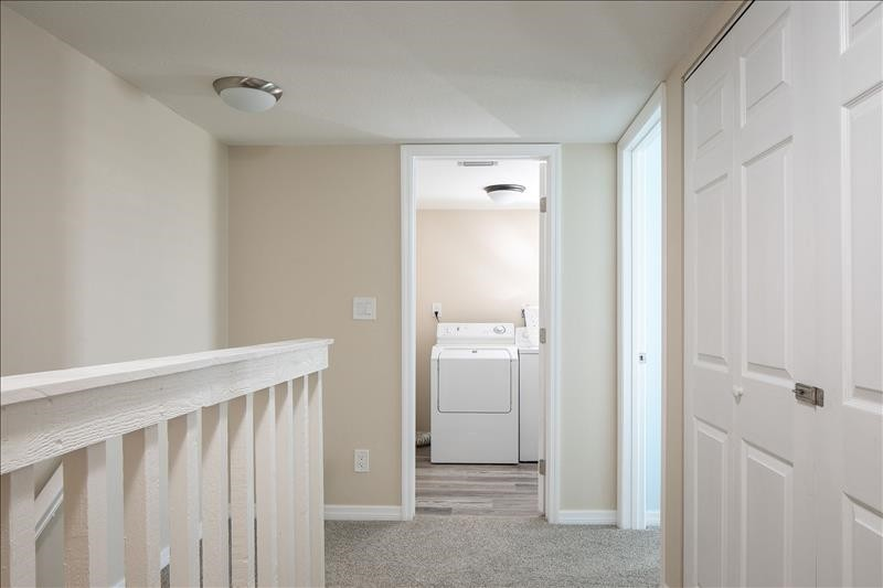 upstairs hallway with laundry room