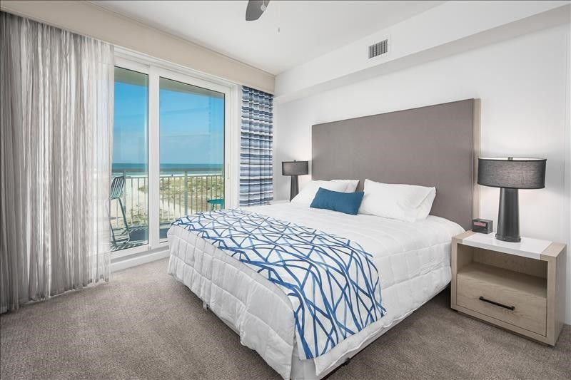 king size bed master bedroom with beach view