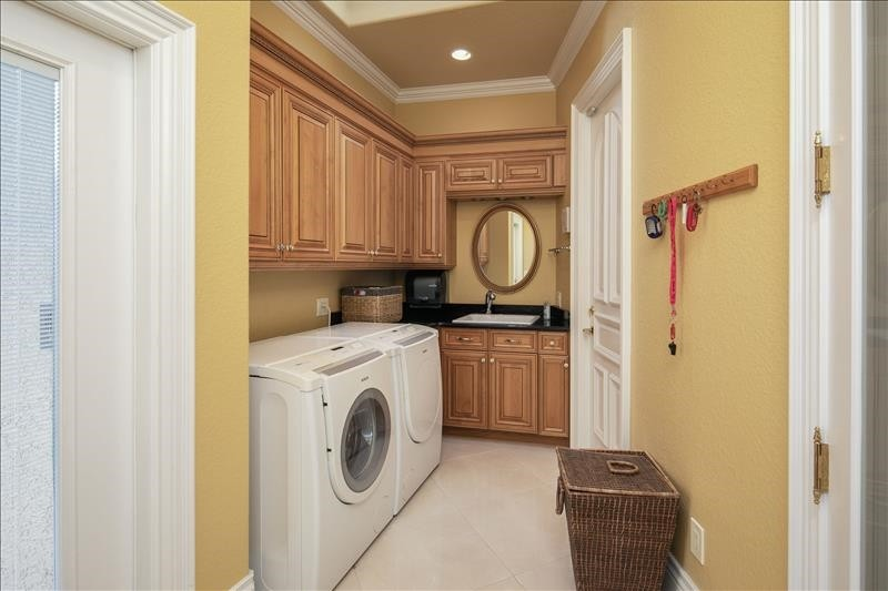 main floor laundry and large walk in pantry
