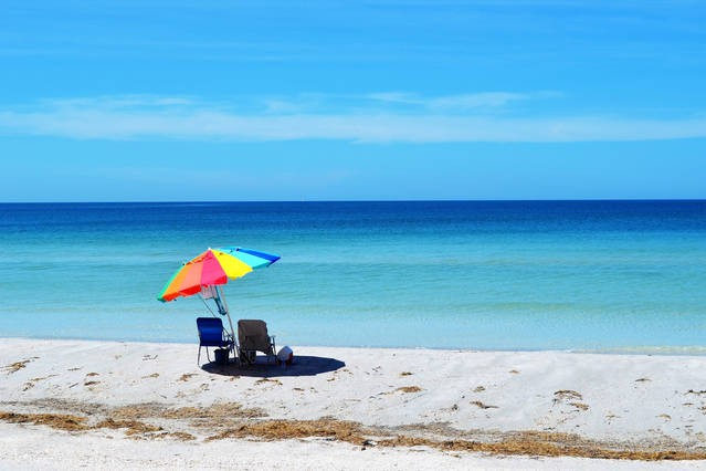 Florida white sandy beaches and blue-green waters