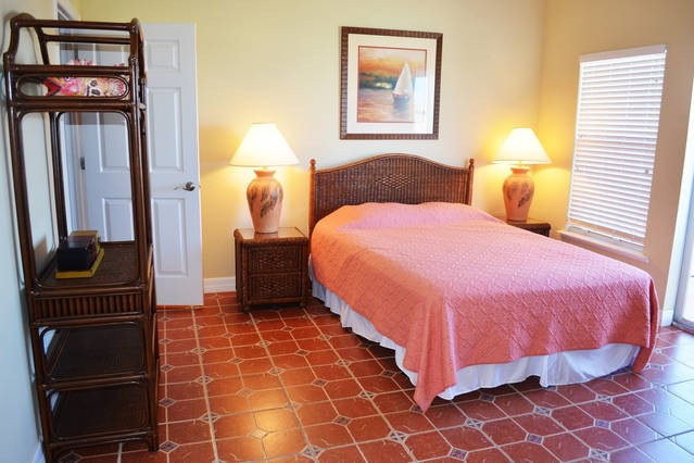 Relax in this large master bedroom with private balcony!