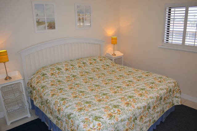 King sized bed with partial intracoastal view